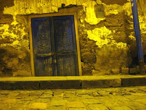 The door to a mud home on a side street in Cuzco.